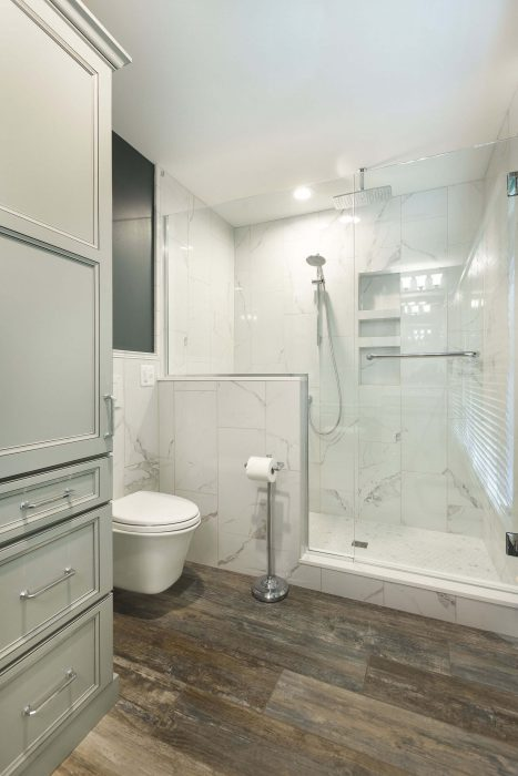 Bathroom With Mounted Toilet And Tile Shower