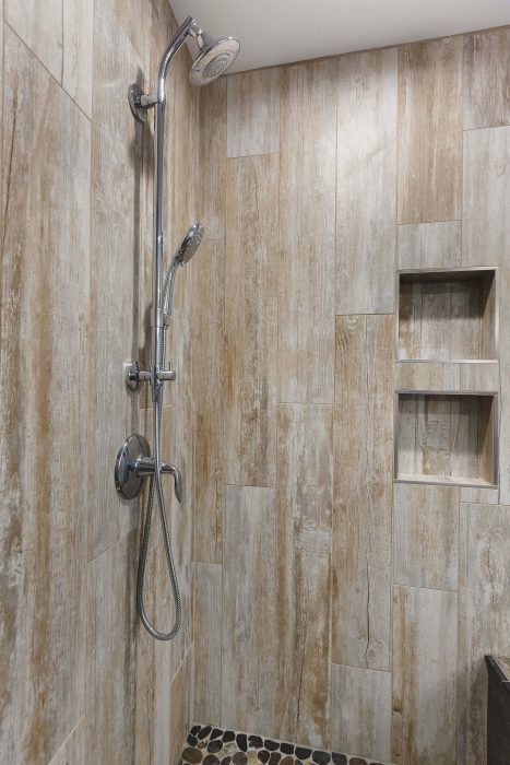 Shower Niche In Dark Tile Bathroom Remodel