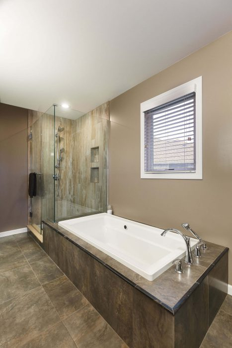 Master Bath Tub With Dark Tiles
