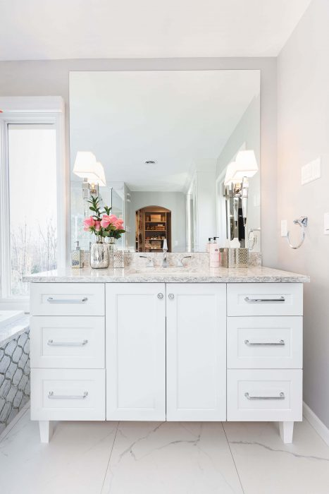 Master Suite Remodel White Vanity with Large Mirror