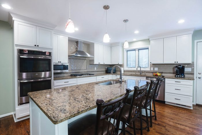 White Open Kitchen Remodel With Double Ovens