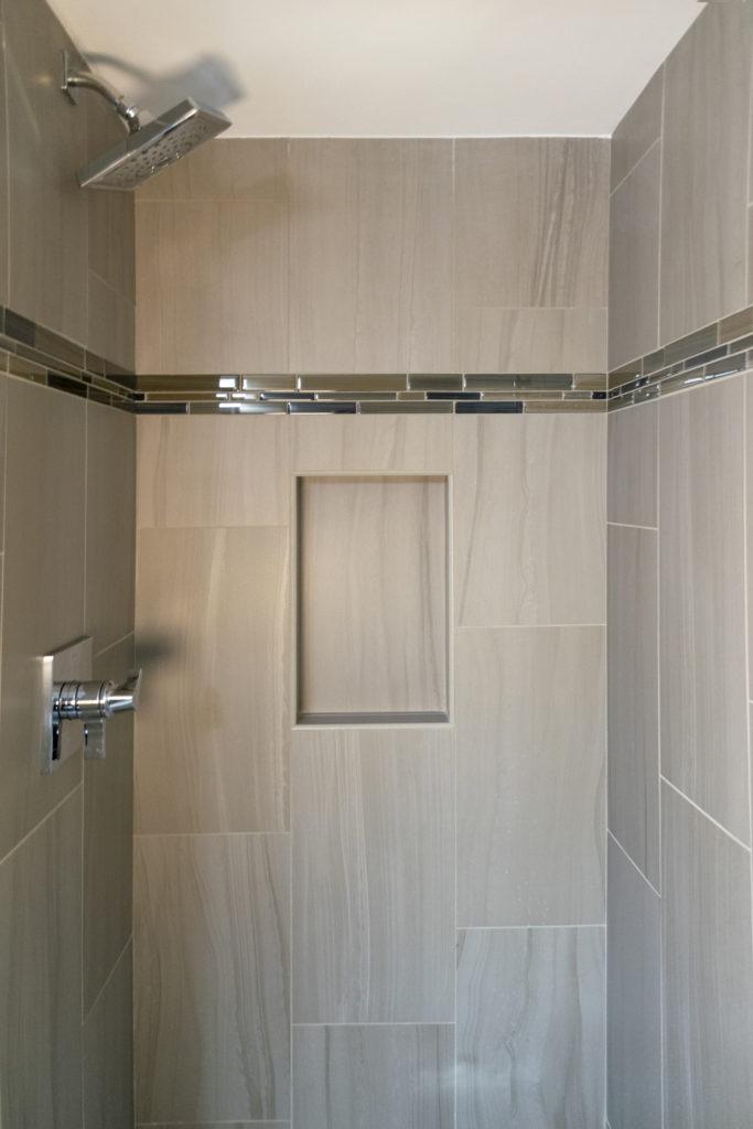 https://www.dropbox.com/s/qilvtt91byyueib/finished%20basement%20remodel%20bathroom%20light%20tile%20shower.jpg?dl=0 Basement Remodel with Bathroom in Bloomfield Hills