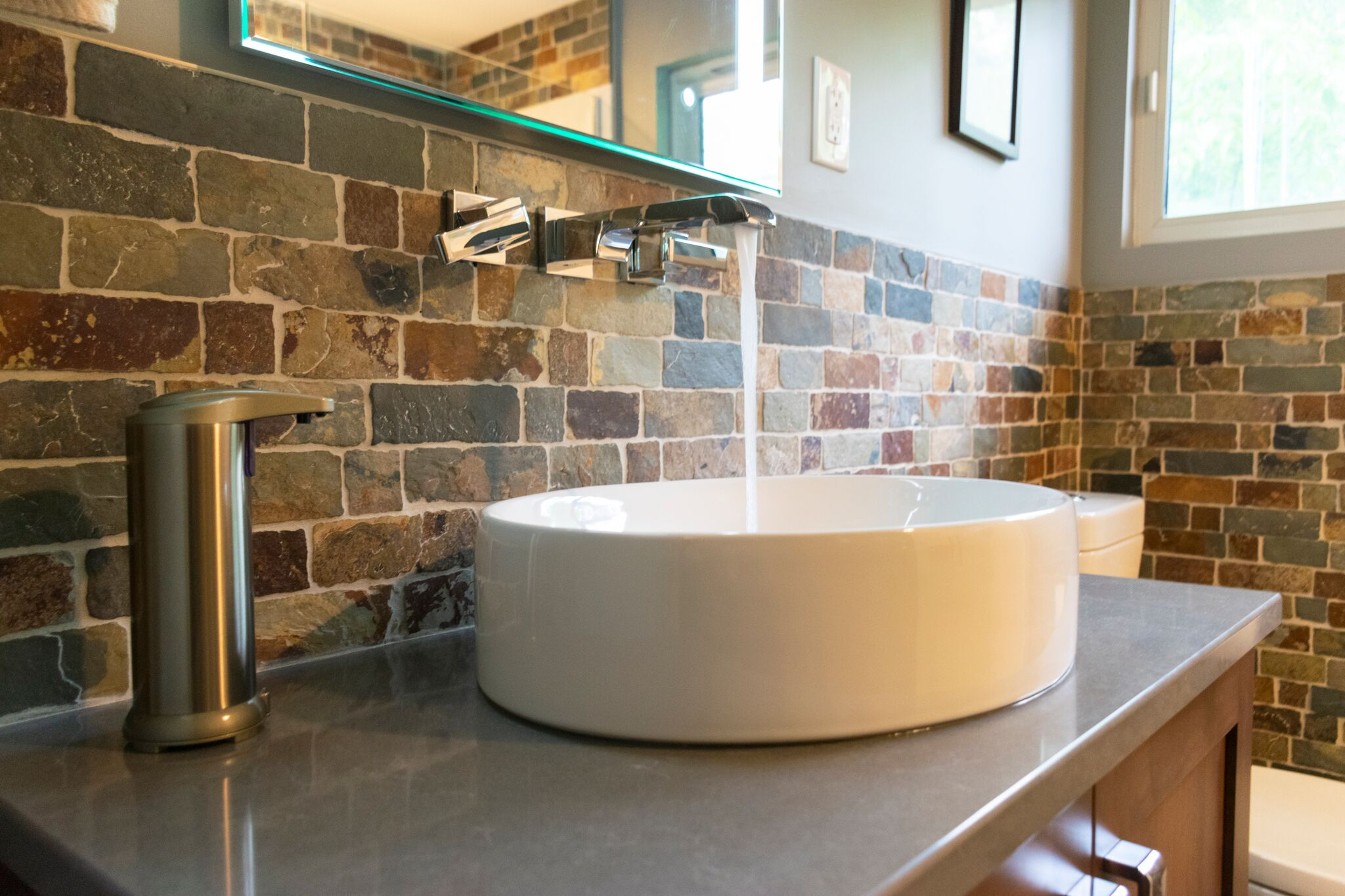 Bathroom Remodel with brick backsplash